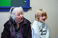 NWA Democrat-Gazette/CHARLIE KAIJO Anne Mainers of Rogers (from left) and Lauren Hightower, 4, sing a Christmas carol, Monday, December 2, 2019 during the Storytime Express early childhood development program at the Rogers Public Library in Rogers.<br /> <br /> Storytime Express is a traditional storytime for ages 3-5 years. Children read stories, sing songs, do movement rhymes and make a craft. Each week they focus on a different letter of the alphabet. Programs at the library will conclude during the week of Christmas and will resume again after the new year.
