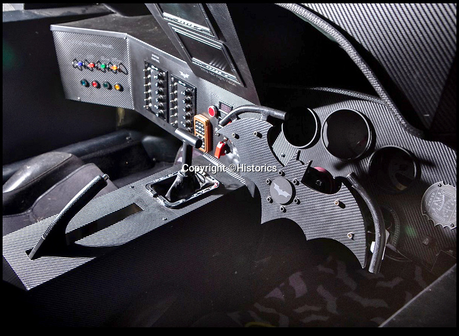 BNPS.co.uk (01202 558833)<br /> Pic:  Historics/BNPS<br /> <br /> The ultra-realistic interior, complete with bat shaped steering wheel.<br /> <br /> A breathtaking recreation of the batmobile used in the Dark Knight trilogy has emerged for sale for a staggering £120,000.<br /> <br /> The stunningly accurate vehicle is based on the chassis of a standard Toyota MR2 sports car and took a full year to transform.<br /> <br /> It is now almost identical to the famous vehicle used in the movies and is even fitted with a flame thrower at the rear of the car.