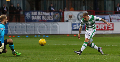 05.04.2016. Dens Park, Dundee, Scotland. Scottish Football Premiership Dundee versus Celtic. Leigh Griffiths goes through on goal but his shot is straight at Scott Bain and saved
