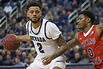 Nevada  guard Jalen Harris (2) drives past Fresno State guard New Williams (0) during the first half of a basketball game played at Lawlor Events Center in Reno, Nev., Saturday, Feb. 22, 2020.