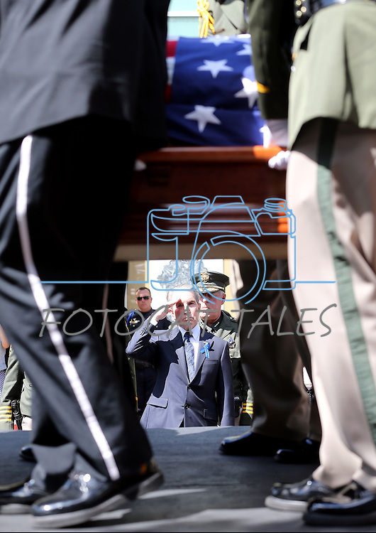 Carson City Mayor Bob Crowell salutes as Honor Guard members unload the casket of Carson City Sheriff's Deputy Carl Howell at the Reno Events Center in Reno, Nev., on Thursday, Aug. 20, 2015. Howell was shot and killed early Saturday morning after responding to a domestic violence call. (Cathleen Allison/Las Vegas Review-Journal)