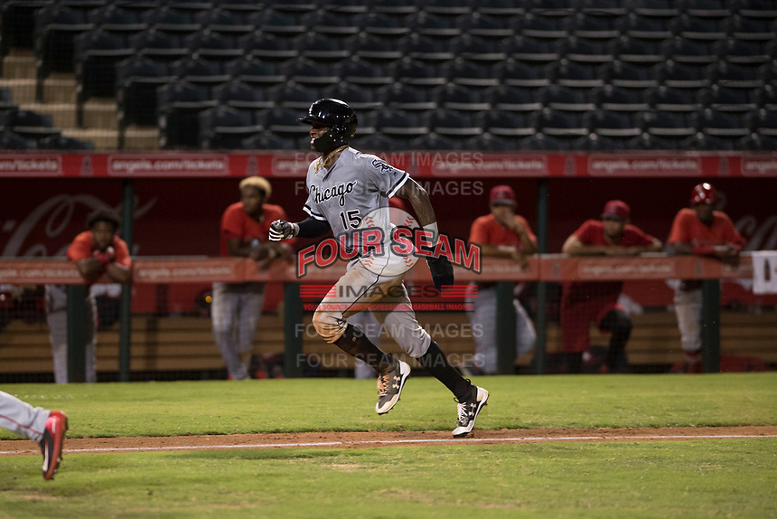 Center fielder Luis Robert (15), on rehab assignment with the AZL White Sox, hustles down the third base line to score a run on a wild pitch during an Arizona League game against the AZL Angels at Tempe Diablo Stadium on August 3, 2018 in Tempe, Arizona. The AZL White Sox defeated the AZL Angels 6-4. (Zachary Lucy/Four Seam Images)