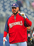 13 April 2009: Washington Nationals' first baseman Nick Johnson awaits his turn in the batting cage prior to facing the Philadelphia Phillies at the Nats' Home Opener at Nationals Park in Washington, DC. The Nats fell short in their 9th inning rally, losing 9-8, and marking their 7th consecutive loss of the season. Mandatory Credit: Ed Wolfstein Photo