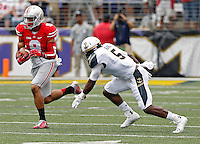 Ohio State Buckeyes wide receiver Devin Smith (9) heads up field after a catch against Navy Midshipmen cornerback Quincy Adams (5) in the 1st quarter of their NCAA game at M&T Bank Stadium in Baltimore, Maryland on August 30, 2014. (Dispatch photo by Kyle Robertson)
