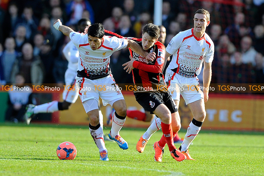 Luis Su?rez of Liverpool holds off Harry Arter of AFC Bournemouth - AFC Bournemouth vs Liverpool - FA Cup 4th Round Football at the Goldsands Stadium, Bournemouth, Dorset - 25/01/14 - MANDATORY CREDIT: Denis Murphy/TGSPHOTO - Self billing applies where appropriate - 0845 094 6026 - contact@tgsphoto.co.uk - NO UNPAID USE