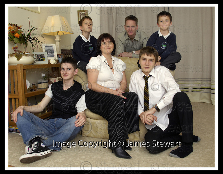 14/11/2007       Copyright Pic: James Stewart.File Name : sct_jspa02_dryburgh.BUDGET CASE STUDY.MARIANNE DRYBURGH FROM FALKIRK WITH HER FAMILY.... REAR - FRASER, MARK (HUSBAND), RORY... FRONT- LEWIS, CAMERON.....James Stewart Photo Agency 19 Carronlea Drive, Falkirk. FK2 8DN      Vat Reg No. 607 6932 25.Office     : +44 (0)1324 570906     .Mobile   : +44 (0)7721 416997.Fax         : +44 (0)1324 570906.E-mail  :  jim@jspa.co.uk.If you require further information then contact Jim Stewart on any of the numbers above........