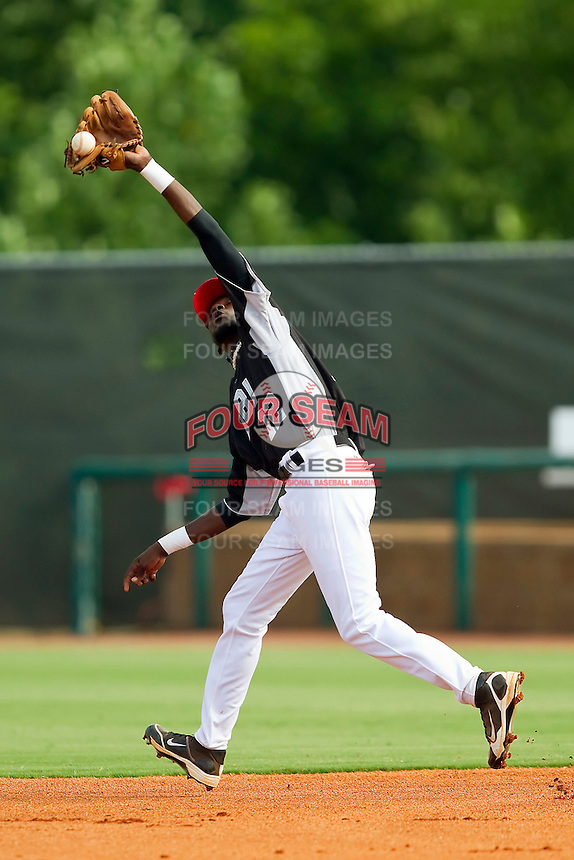 Second baseman DeJohn Suber #12 of RBI can't handle this fly ball against American Legion at the 2011 Tournament of Stars at the USA Baseball National Training Center on June 25, 2011 in Cary, North Carolina.  RBI defeated American Legion by the score of 8-7. (Brian Westerholt/Four Seam Images)