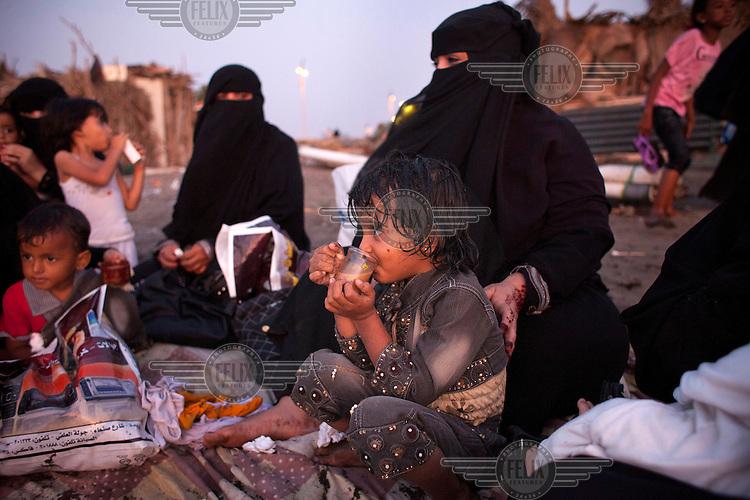 Families meet at dusk on the beach of the Red Sea in Hodeidah City.