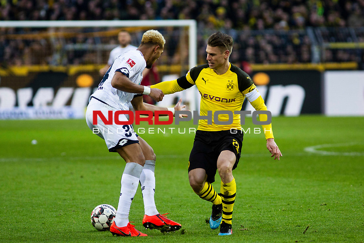 09.02.2019, Signal Iduna Park, Dortmund, GER, 1.FBL, Borussia Dortmund vs TSG 1899 Hoffenheim, DFL REGULATIONS PROHIBIT ANY USE OF PHOTOGRAPHS AS IMAGE SEQUENCES AND/OR QUASI-VIDEO<br /> <br /> im Bild | picture shows:<br /> Joelinton (Hoffenheim #34) im Duell mit Lukasz Piszczek (Borussia Dortmund #26), <br /> <br /> Foto © nordphoto / Rauch
