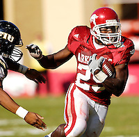 Florida International University Golden Panthers versus the University of Arkansas Razorbacks at Donald W. Reynolds Razorback Stadium, Fayetteville, Arkansas on Saturday, October 27, 2007.  The Razorbacks defeated the Golden Panthers, 58-10...Arkansas tailback Felix Jones (25) rushes in the third quarter.  Jones recorded a total of 90 yards rushing and a touchdown against FIU.