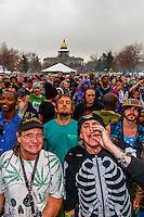 Crowd smoking pot at 4:20 PM, 420 Cannabis Culture Music Festival, Civic Center Park, Downtown Denver, Colorado USA.