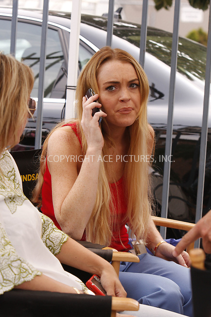 WWW.ACEPIXS.COM . . . . .  ....July 22 2008, New York City....Actress Lindsay Lohan was on the set of the TV show 'Ugly Betty', filming a scene with America Ferrera on July 22 2008 in Long Island City, Queens, New York.....Please byline: AJ SOKALNER - ACE PICTURES.... *** ***..Ace Pictures, Inc:  ..tel: (646) 769 0430..e-mail: info@acepixs.com..web: http://www.acepixs.com