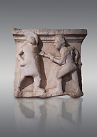 Roman relief sculptures of gladiator fights 3rd century AD from Hierapolis Northern Necropolis. Hierapolis Archaeology Museum, Turkey. Against a grey background