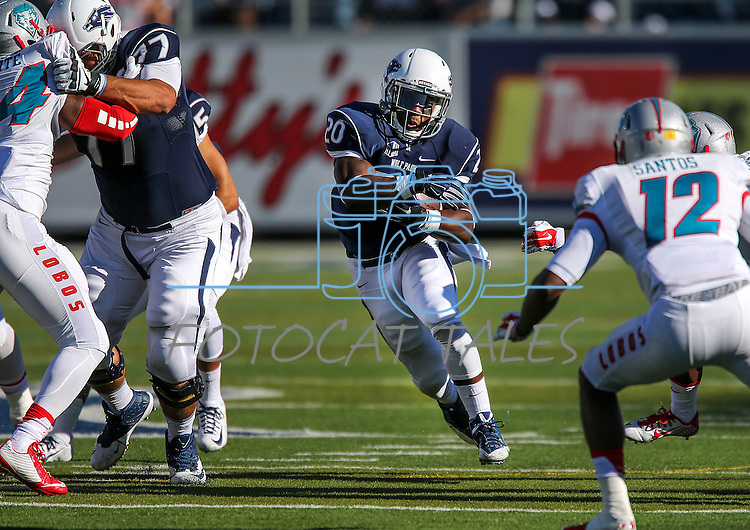 Nevada's James Butler runs against New Mexico in an NCAA college football game in Reno, Nev., on Saturday, Oct. 10, 2015. Nevada won 35-17. (AP Photo/Cathleen Allison)