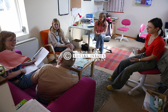 Support Workers in discussion with Service User of the Advice and Information Resource Centre,