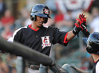 Shortstop Luis Sardinas (9) of the Hickory Crawdads in a game against the Greenville Drive on April 9, 2012, at Fluor Field at the West End in Greenville, South Carolina. Sardinas is the Texas Rangers' No. 17 prospect, according to Baseball America. (Tom Priddy/Four Seam Images)