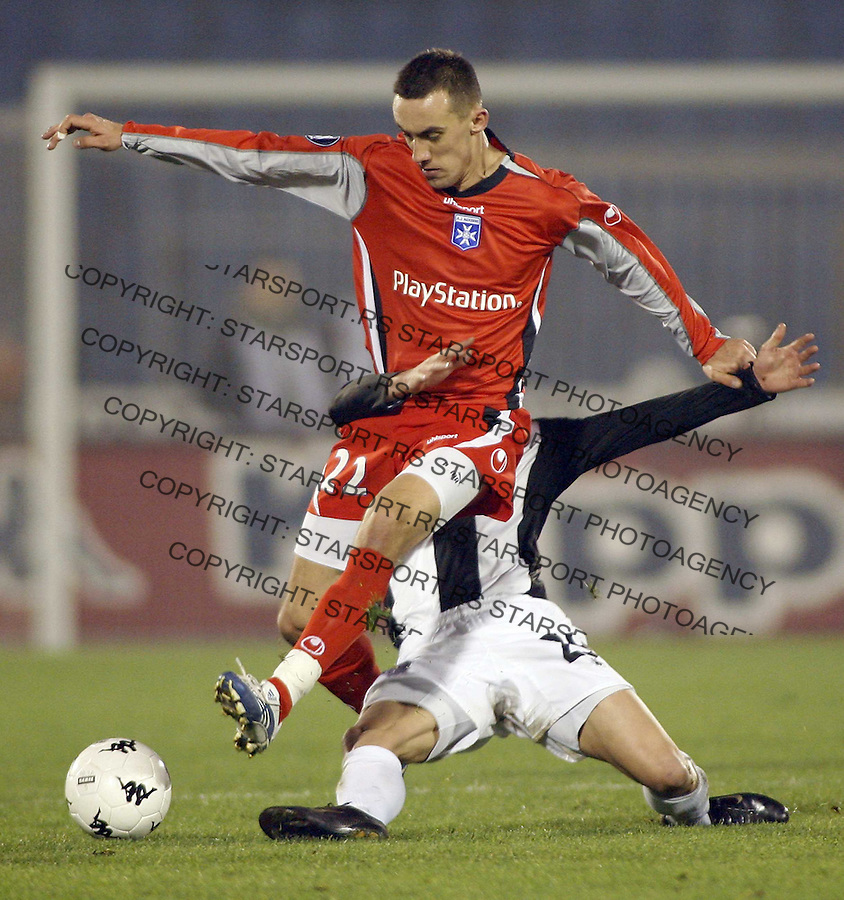 Auxerre  player Jelen Ireneusz, infront, is challanged by Nenad Marinkovic, behind, from Partizan Belgrade, during Uefa Cup Group A  match between Partizan and Auxerre, at stadium in Belgrade, Serbia , Wednesday, November 29, 2006. (Srdjan Stevanovic) &amp;#xA;<br />