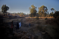 """people walk in the neighborhood of the city of Gonder in northern Ethiopia where 9000 so called """"Falash Mura"""" now live on Sunday january 11 2009...Gonder hosts a population of around 9000 so called """"Falash Mura"""", supposed Ethiopian Jews who were forced to convert to Christianity. The Israeli Government is still verifying their claims  and if a clear link between them and Israel would be established they would have the right to return to their mother land. In the mean time Israeli and other Jewish non governmental organizations are working in support of this community."""