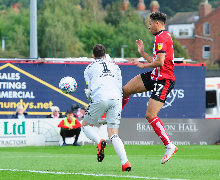 Lincoln City's Tyler Walker scores the opening goal, getting to the ball before Sunderland's Jon McLaughlin<br /> <br /> Photographer Chris Vaughan/CameraSport<br /> <br /> The EFL Sky Bet League One - Lincoln City v Sunderland - Saturday 5th October 2019 - Sincil Bank - Lincoln<br /> <br /> World Copyright © 2019 CameraSport. All rights reserved. 43 Linden Ave. Countesthorpe. Leicester. England. LE8 5PG - Tel: +44 (0) 116 277 4147 - admin@camerasport.com - www.camerasport.com