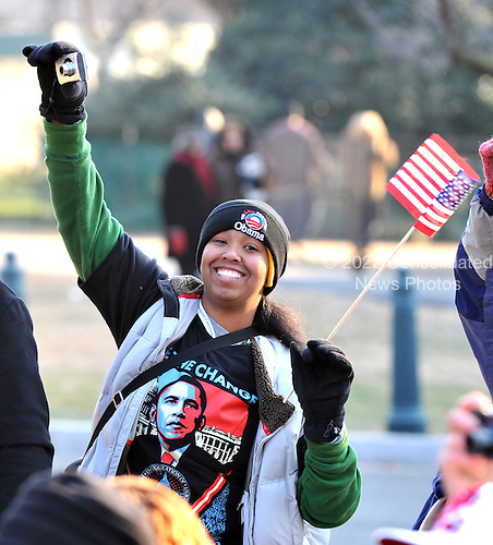 Washington, DC - January 20, 2009 -- Unidentified spectator wearing an Obama t-shirt and ski hat watches the Inaugural Parade on Constitution Avenue near the U. S. Capitol in Washington, D.C. on Tuesday, January 20, 2009..Credit: Ron Sachs - Pool via CNP