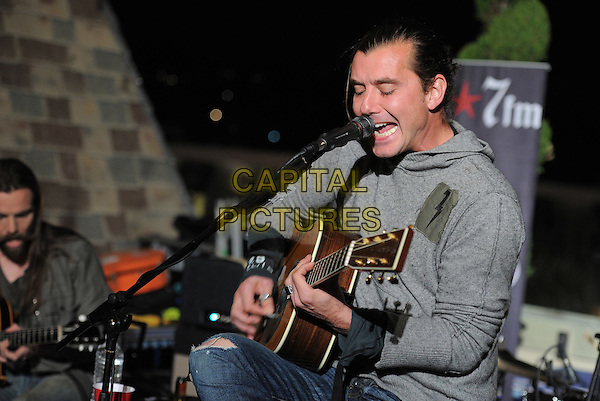 Gavin Rossdale.98.7FM Presents Bush  in an exclusive live performance at the 98.7FM Penthouse inside the Historic Hollywood Tower in Hollywood, California, USA..January 31st, 2012     .on stage in concert live gig performance performing music half length grey gray hooded top singing                                                                       .CAP/RKE/DVS.©DVS/RockinExposures/Capital Pictures.