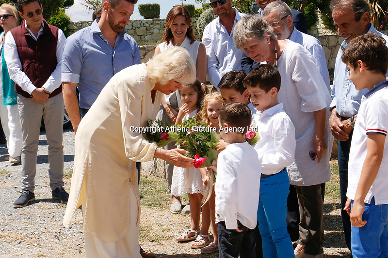 Pictured: The Duchess of Cornwall receives flowers from local children at Lyraraki Winemakers in ALagni, Crete, Greece. Friday 11 May 2018 <br /> Re: Duchess of Cornwall visits Lyraraki Winemakers on the island of Crete, Greece.