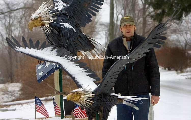 BETHLEHEM CT. 02 December 2014-010214SV06-Ray White of Bethlehem stands with his patriotic Eagles outside his home in Bethlehem Thursday.<br /> Steven Valenti Republican-American