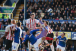 "Southampton defender Jos Hooiveld (red shirt) leaping above Portsmouth goalkeeper Stephen Henderson during the first half of their Championship fixture at Fratton Park stadium, Portsmouth. Around 3000 away fans were taken directly to the game in a fleet of buses in a police operation known as the ""coach bubble"" to avoid the possibility of disorder between rival fans. The match ended in a one-all draw watched by a near capacity crowd of 19,879."