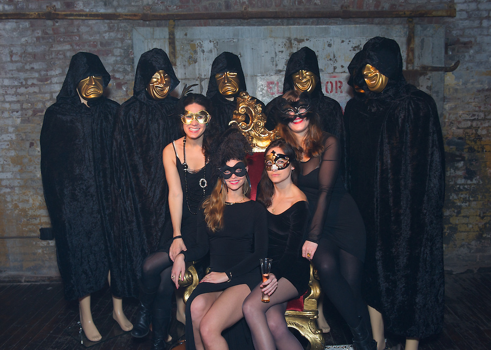 Guests in masks at the Veuve Clicquot Champagne Yelloween party in New York