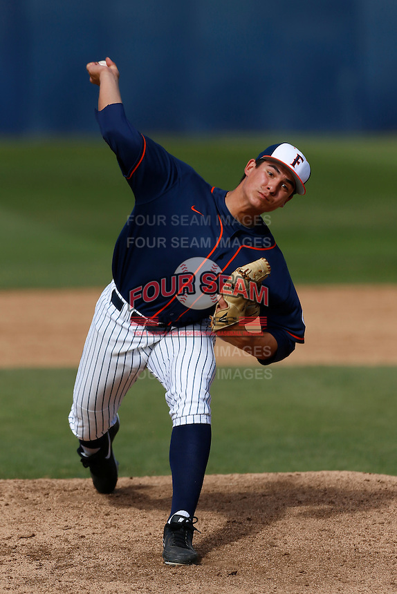 Henry Omana #34 of the Cal State Fullerton Titans pitches against the Oregon Ducks at Goodwin Field on March 3, 2013 in Fullerton, California. (Larry Goren/Four Seam Images)