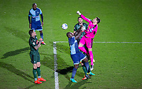 Goalkeeper Luke McCormick of Plymouth Argyle punches clear of Adebayo Akinfenwa of Wycombe Wanderers during the Sky Bet League 2 match between Wycombe Wanderers and Plymouth Argyle at Adams Park, High Wycombe, England on 14 March 2017. Photo by Andy Rowland / PRiME Media Images.