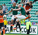 Hibs' Farid el Alagui, Lewis Allan and Dundee Utd's Callum Morris  challenge for the ball.