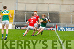 Paul Walsh of Kerry tries to go around Bill Curtin of Cork in the U20 John Kerins Cup football game in Austin Stack Park on Saturday.