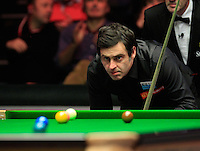 Ronnie O'Sullivan looks to play his way out of a safety shot during the Dafabet Masters FINAL between Barry Hawkins and Ronnie O'Sullivan at Alexandra Palace, London, England on 17 January 2016. Photo by Liam Smith / PRiME Media Images