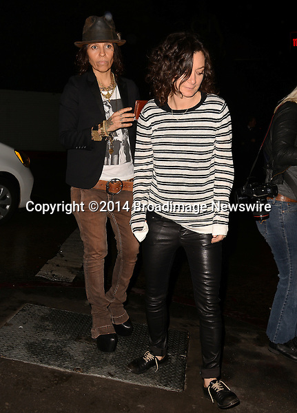 Pictured: Linda Perry, Sara Gilbert<br /> Mandatory Credit: Luiz Martinez / Broadimage<br /> Annie Leibovitz Book Launch - Outside Arrivals<br /> <br /> 2/26/14, West Hollywood, California, United States of America<br /> Reference: 022614_LMLA_BDG_090<br /> <br /> sales@broadimage.com<br /> Bus: (310) 301-1027<br /> Fax: (646) 827-9134<br /> http://www.broadimage.com