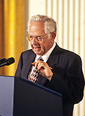 Dave Thomas, founder and chief executive officer of the fast-food chain Wendy's, makes remarks advocating the expanded use of the internet to place adoptions during an event hosted by United States President Bill Clinton in the East Room of the White House in Washington, DC on November 24, 1998.<br /> Credit: Ron Sachs / CNP