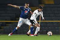 BOGOTA - COLOMBIA – 28 - 02 - 2018: Andres Cadavid (Izq.) jugador de Millonarios (COL), disputan el balon con Matheus Vital (Der.) jugador de Corinthians (BRA), durante partido entre Millonarios (COL) y Corinthians (BRA), de la fase de grupos, grupo 7, fecha 1 de la Copa Conmebol Libertadores 2018, en el estadio Nemesio Camacho El Campin, de la ciudad de Bogota. / Andres Cadavid (L) player of Millonarios (COL), fights for the ball with Matheus Vital (R) player of Corinthians (BRA), during a match between Millonarios (COL) and Corinthians (BRA), of the group stage, group 7, 1st date for the Conmebol Copa Libertadores 2018 in the Nemesio Camacho El Campin stadium in Bogota city. VizzorImage / Luis Ramirez / Staff.
