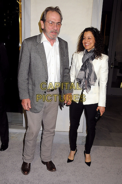 Tommy Lee Jones & Dawn Laurel .Tom Ford Cocktail Party held at the Tom Ford Store, Beverly Hills, California, USA..February 21st, 2013.full length white shirt grey gray suit jacket beige trousers glasses beard facial hair holding hands blazer scarf black trousers married husband wife .CAP/ADM/BP.©Byron Purvis/AdMedia/Capital Pictures.