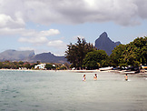 MAURITIUS, Tamarin, kids play in the water of Tamarin Bay, Indian Ocean