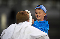 "Batavia Muckdogs young fan ""Pies an Intern"" promotion during a game against the Williamsport Crosscutters on August 27, 2015 at Dwyer Stadium in Batavia, New York.  Batavia defeated Williamsport 3-2.  (Mike Janes/Four Seam Images)"