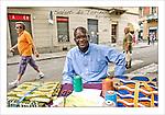Cartoline da Barriera di Milano<br /> Il sarto senegalese Malick Niang