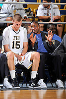 28 January 2012:  FIU Head Coach Isiah Thomas speaks with center Gilles Dierickx (15) in the first half as the Western Kentucky University Hilltoppers defeated the FIU Golden Panthers, 61-51, at the U.S. Century Bank Arena in Miami, Florida.
