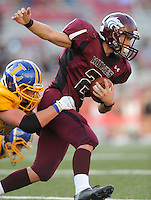 STAFF PHOTO ANDY SHUPE - Lincoln running back Charles Rowe carries the ball as he is tackled by Hot Springs Lakeside linebacker Colt Housley during the first half of play Monday, Sept. 1, 2014, at Razorback Stadium in Fayetteville.