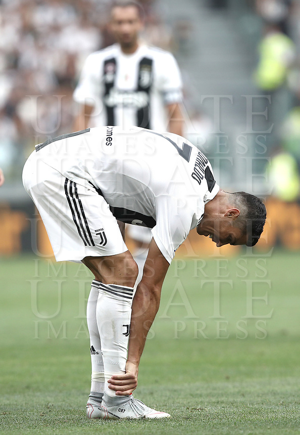Calcio, Serie A: Juventus - Lazio, Torino, Allianz Stadium, 25 agosto, 2018.<br /> Juventus' Cristiano Ronaldo checks his ankle<br /> during during the Italian Serie A football match between Juventus and Lazio at Torino's Allianz stadium, August 25, 2018.<br /> UPDATE IMAGES PRESS/Isabella Bonotto