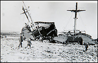 BNPS.co.uk (01202 558833)<br /> Pic: BNPS<br /> <br /> A shipwreck on the beach at Dunkirk.<br /> <br /> Haunting photos which capture the trail of devastation left in the wake of the Dunkirk evacuation have been unearthed after 77 years.<br /> <br /> The poignant pictures were taken soon after 330,000 Allied troops had been rescued from the beaches by an armada of little ships having been defeated by the Germans.<br /> <br /> The epic operation is about to be the subject of the new Hollywood blockbuster movie 'Dunkirk' will stars Tom Hardy and Harry Styles and is die for release on July 21.<br /> <br /> The black and white snaps show German soldiers surveying the wreckage which included destroyed ships and large military trucks lying in the surf.<br /> <br /> They are being sold by Duke's Auctioneers.