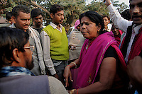 Sampat Pal devi reacting violently against a man who passed a bad comment on a lady in front of her. Her name is known in the area but lots of people do not know her by face. Sampat pal Devi the commander of Gulabi Gang fights for women empowerment, justice and rights among the poor people of Bundelkhand region of Uttar Pradesh. Sampat Pal Devi comes from a poor family in Bundelkhand - the poorest region of India. The region is fraught with abject poverty, gross under development, lack of law and order, and stark casteism in which the Brahmins and other higher caste people treat their low caste brethren with disdain. Out of such situation when Sampat Pal Devi decided to speak up for the poor, she has been winning heart felt gratitude of the poor as well as enmity of the high caste people and grudging respect of the law enforcement officials who used to be largely inactive in these badlands of North India. Initially, she began with helping distressed women - victims of domestic violence and dowry system, but soon started getting other cases of nature of land dispute and under development. She emerged as a fiery leader in 2007, when she beat up the OC of the local police station while demanding release of a dalit woman kept locked up in the cell for thirteen days without being charged with a case.Today, she has a huge fan following of some 25 hundreds of thousands of women (spread across 8 districts of the state of UP) who have come to be known as Gulabi Gang or Pink Vigilante Women for their vibrant pink sarees - the costume of the gang; and fiery nature of dealing with injustice. When verbal negotiations for justice fail they resort to beating up. Sampat Devi is viewed as a messiah with the promise of bringing back law and order for the poor, in these mafia troubled areas. Today, perpetrators are simply scared of her as she does not hesitate to challenge law and order and even system - to win justice for the poor. More complaints related to domestic violence and oth