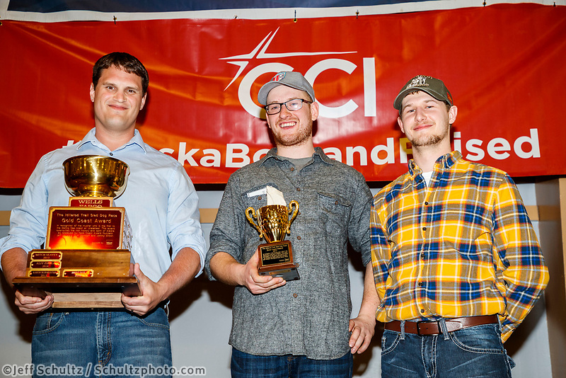 The Wells Fargo Gold Coast Award is presented by Drew McCann, Nome branch manager, and Jake Slingsby,&nbsp;vice president and senior business relationship manager,&nbsp;for&nbsp;Wells Fargo to Wade Marrs at the Nome Musher's Award Banquet during the 2017 Iditarod on Sunday March 19, 2017.<br /> <br /> Photo by Jeff Schultz/SchultzPhoto.com  (C) 2017  ALL RIGHTS RESERVED