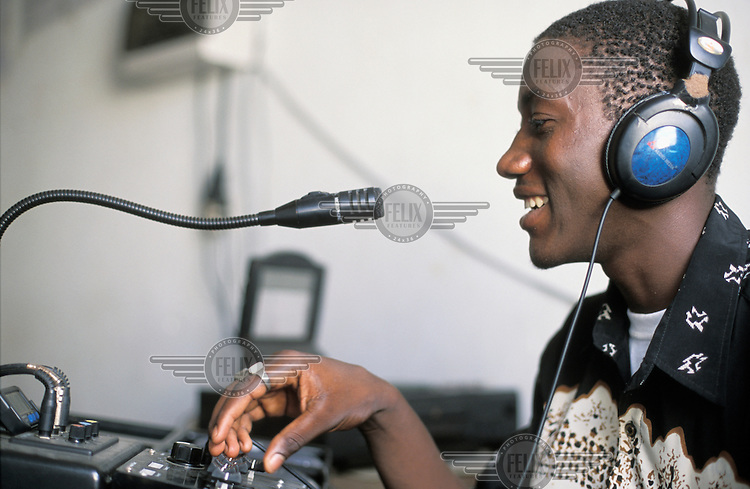 DJ at a local radio station, presenting a programme about HIV and AIDS.