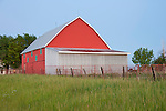 Red metal barn at dusk, rural Missouri.