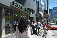 Toronto,  CANADA - File Photo - Downtown Toronto - starbucks coffee shop<br /> <br /> Photo :  Agence Quebec Presse - Pierre Roussel